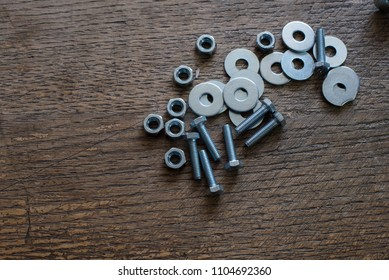 washers and bolts with nuts on table