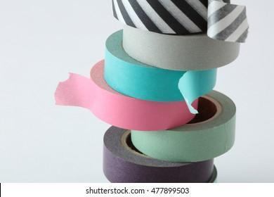 Washi tape rolls, masking tape rolls in pile.