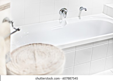 Washing area with ceramic tub, mirror is attached to wall, very comfortable  area, perfect lights, glass door can see near walls, ceramics  are shiny.