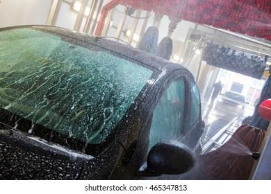 Washing an auto at the car wash carwash