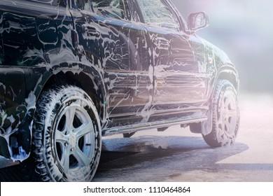Washing the black car.