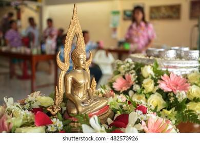 washing Buddha statue during Thailand new year festival