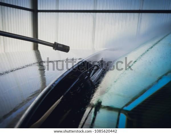 Washing a car in a self-operated car wash