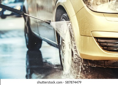 Washing car with soap. Close up concept.