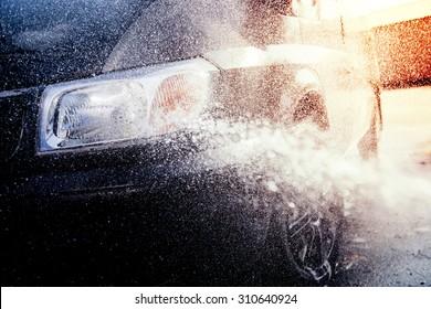 Washing car with water splash