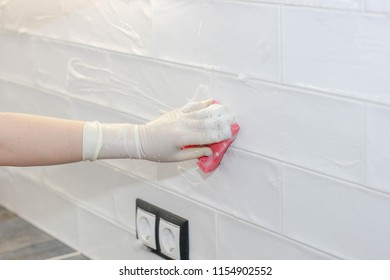 O Washing And Cleaning Ceramic White Tiles On The Wall In Kitchen