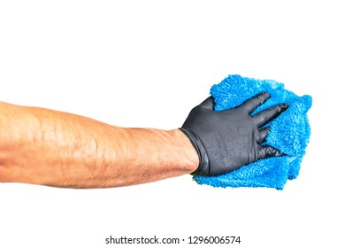 Washing concept. A male man hand with cloth isolated on white background. Worker cleaning. Cleaning with cloth, foam and brush. Cleaning concept. Hand in black protective rubber glove