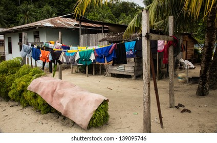 washing day, Yenwaupnor Village, Palau Gam, Raja Ampat