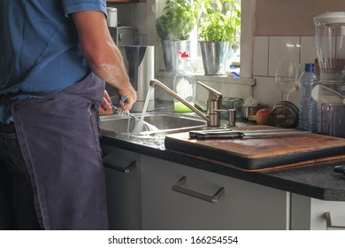 washing dishes in the kitchen with sunlight on water
