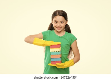 Washing dishes is my pleasure. Small housekeeper holding dish sponges in rubber gloves. Little housemaid ready for household help. Adorable kitchen maid. Household duties. Cleaning and washing up.