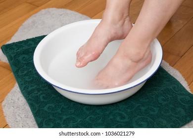 washing feet to prepare for treatment