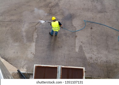 washing the floor in an industrial site