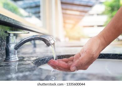 washing hand under running water