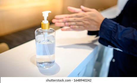 Washing hands by alcohol sanitizers or alcohol gel from pump bottle in public area. Wuhan coronavirus (COVID-19) outbreak infection prevention and control. Hygiene and health care concept