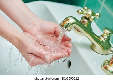 Washing hands. hygiene and dysentery prevention. faucet tap with flowing water