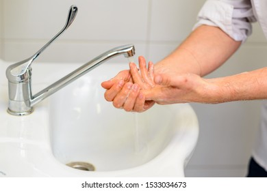 Washing hands with running water under the faucet on sink, Hygiene and promotion of cleanliness and health, health care