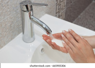 Washing of hands with soap under running water