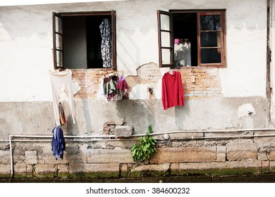 Washing Hanging out a window in the Grand Canal of China