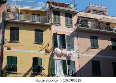 Washing hanging outside the colourful houses in a fishing village. Riomaggiore, Cinque Terre, Italy.