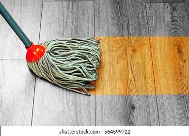 washing hardwood parquet  wooden floor with wet mop