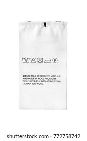 Washing instructions and fabric composition textile clothes label isolated over white