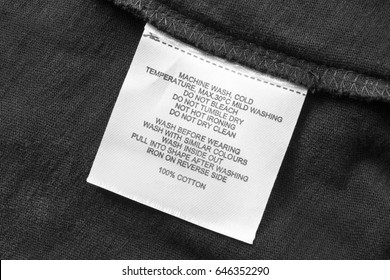 Washing instructions label on black cloth closeup