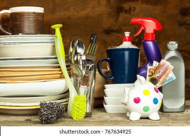 Washing kitchenware. Crockery on a wooden table. Cleaning after home celebration. Housework