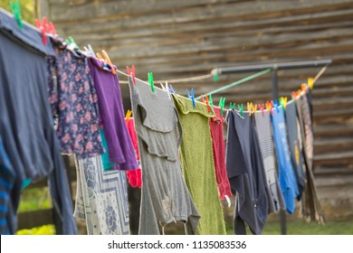 Washing line with drying clothes in outdoor. Clothes hanging on washing line in outdoor.