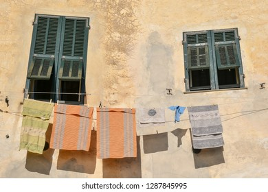 Washing lines in front of closed green shutters, Cervo Ligure, Liguria, Italy