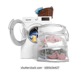 Washing machine and basket with laundry on white background