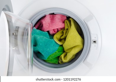 washing machine with color towels, clothes, open