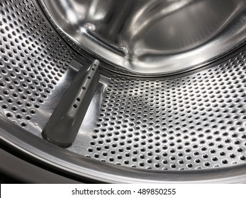 Washing machine drum, perforated metallic background