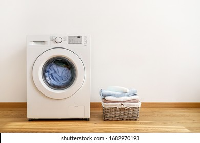 Washing machine, washing gel and laundry basket on white background