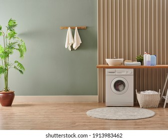 Washing machine in the laundry room style, interior concept, dirty clothes decor coffee table with vase of plant. Wooden bench, sink and towel. - Shutterstock ID 1913983462