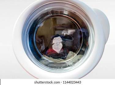 washing machine with rotating dirty loundry inside