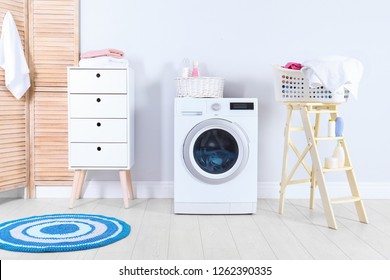 Washing machine with towels in laundry room interior