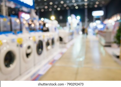Washing machines in home appliance electronic department retail store blur background