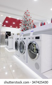 Washing machines, refrigerators and other home appliance in retail store at Christmas sales