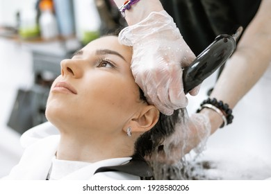 washing off hair care products in the beauty salon, washing hair in the salon