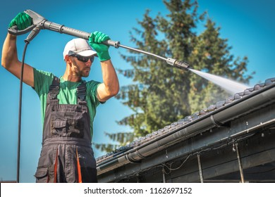 Washing Plastic Transparent Carport Roof by Caucasian Men. Pressure Washer Job.