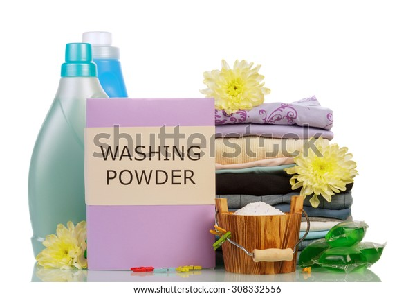 Washing powder and cleaning items on white background