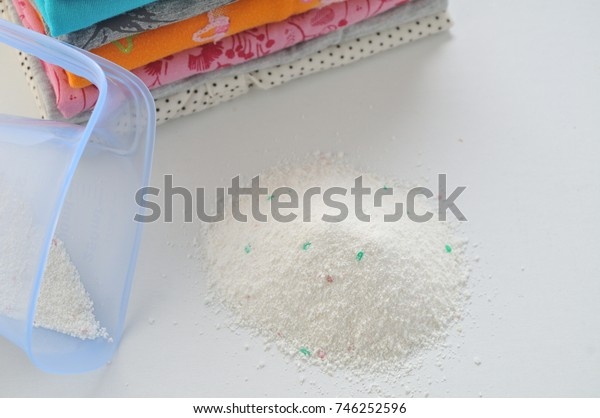 Washing powder for colored cloths on a white background