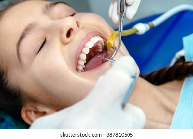 Washing teeth with a dentist at the clinic