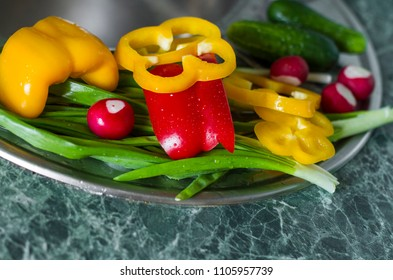 washing vegetables. Preparation of fresh salad. Fresh pepper, cucumber and onions on the sink in a kitchen interior. healthy food concept.