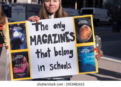 "Washingon, DC - March 24, 2018: March for Our Lives, High School Senior Holding Sign, ""The Only Magazines That Belong in Schools"""