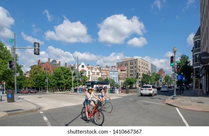 Washingotn, DC, 05 27 2019. Cyclists cross Connecticut Ave NW in the Dupont Circle neighborhood of Washington, DC, on a partly cloudy day in late May 2019.