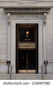 Washington DC—Aug 16, 2018; bronze and glass door entering granite building with ornate trim and letters above it marking it as Chamber of Commerce of the United States.