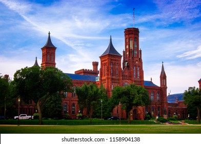 Washington DC—Aug 16, 2018 front entrance of the red brick and blue roof Smithsonian institute castle at sunrise on the national mall in the United States Capital during summer.