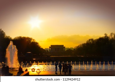 Washington DC—March 21, 2012; people looking at the Lincoln Memorial and reflection pool at sunset in the Capital of the United States