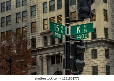 Washington DC—Dec 6, 2018; traffic light pole displays road signs at intersection of K and 15th streets.  K street is the famous home of many lobbying firms in the United States capital.